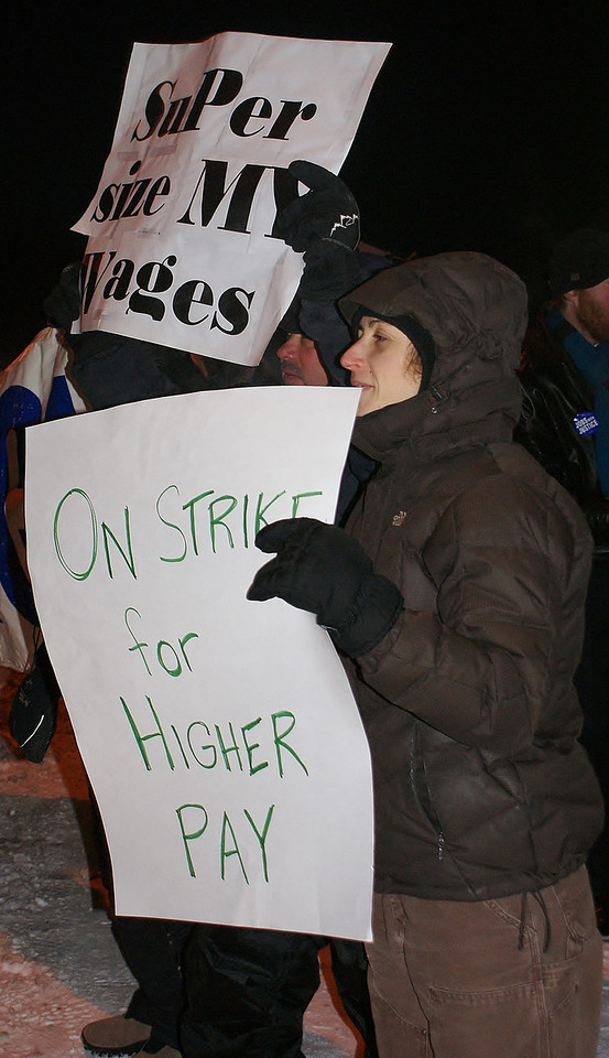 Higher pay for fast food workers was a demand of this woman and others demonstrating outside a Denver area McDonalds.
