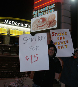 Fast food workers braved single digit temperatures, to demonstrate for better wages, outside a Denver area McDonalds.