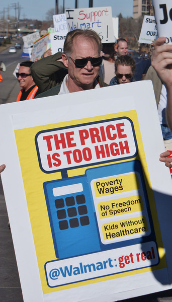 Low wages and lack of health care were issues for this man at a Black Friday protest at a Denver area Walmart.