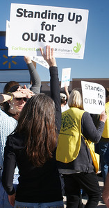 Demonstrators rallied and marched outside a Walmart store on Black Friday, to protest the companies low wages and mistreatment of their workers.