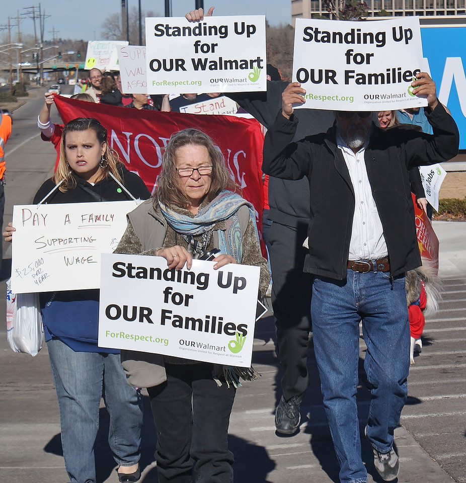 The effect of low wages on workers and their families, was a concern for these marchers at a Black Friday protest in front of a Walmart in suburban Denver, Co.