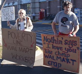 "Poverty level wages and ""cheap products"" were issues for these protesters outside a Walmart store in Boulder, Co. on Black Friday."