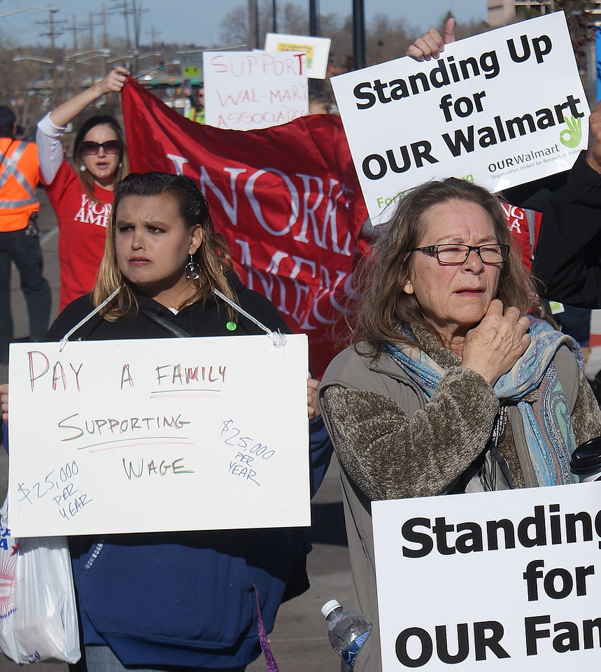 This woman at a Black Friday Walmart protest calls on the company to pay it's workers a minimum wage of $25,000 per year.
