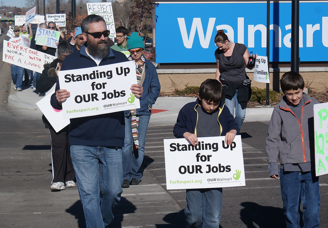 This father and two young sons, joined a Black Frday protest at a Walmart store in suburban Denver.