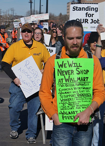 Black Friday protester vows not to shop at Walmart due to the companies low wages and mistreatment of it's workers.
