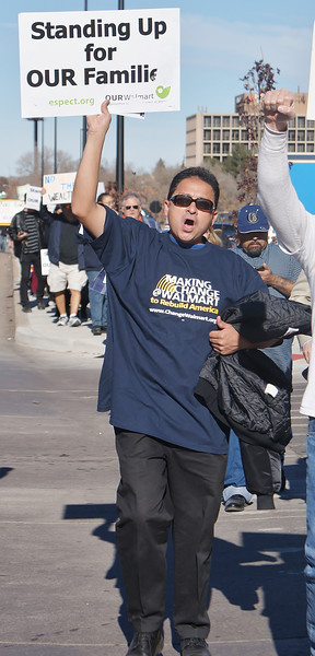 The effect of low wages on workers and their families, was a concern for this man at a Black Friday protest in front of a Walmart in suburban Denver, Co.