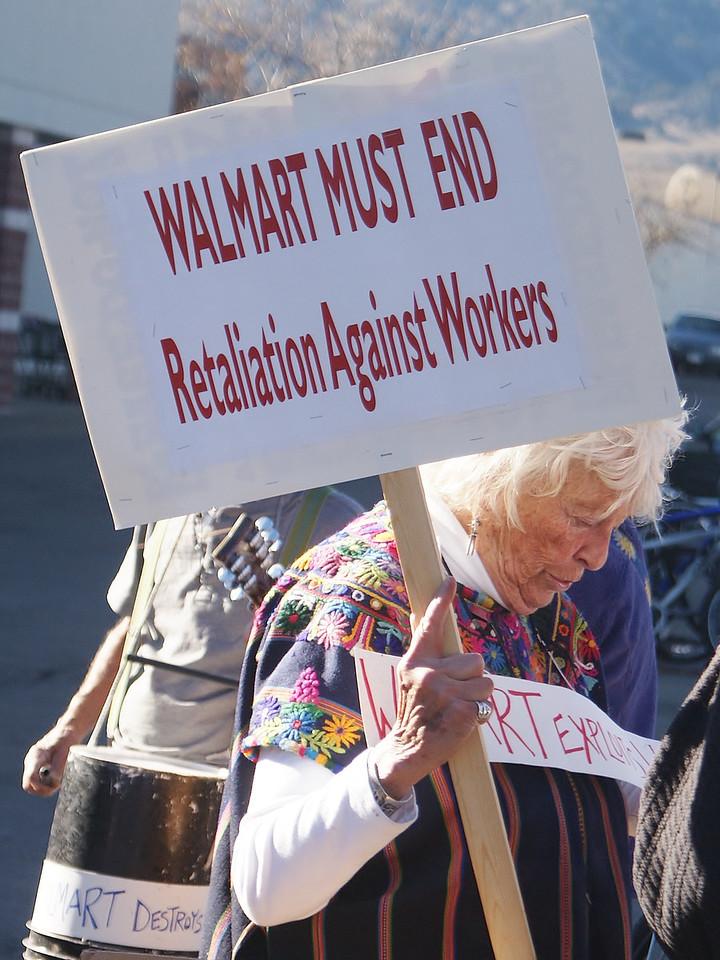 This senior was among Black Friday protesters outside a Walmart store, objecting to the compamies mistreatment of their workers.