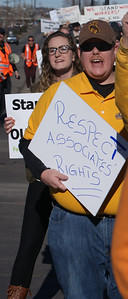 Respect for the rights of workers, was a concern of this protester marching near a Walmart store in suburban Denver, Co., on Black Friday.