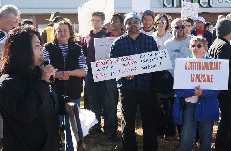 This woman addresses a Black Friday rally for better wages and workers rights, in front of a Walmart in suburban Denver, Co.