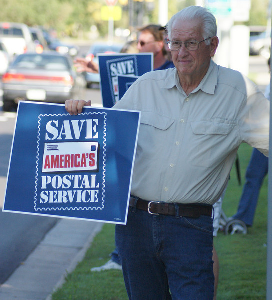 Postal workers & supporters in Boulder, Colorado protest proposed Postal Service cuts (Sept 2011).