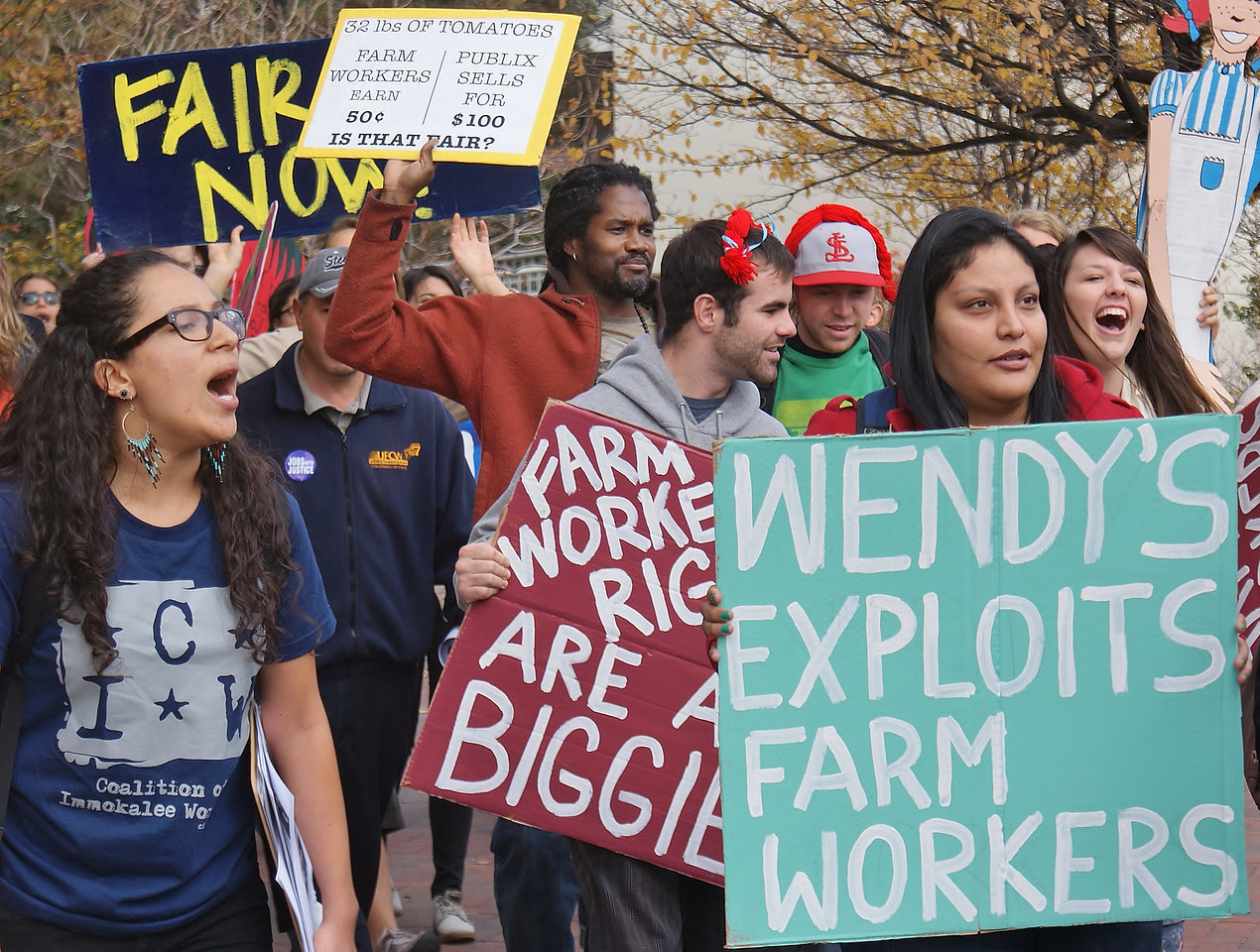 Regis University students, union members, and members of Jobs with Justice, rallied then marched to a local Wendy's to demand the fast food chain join the Fair Food Program to improve the conditions of farmworkers.