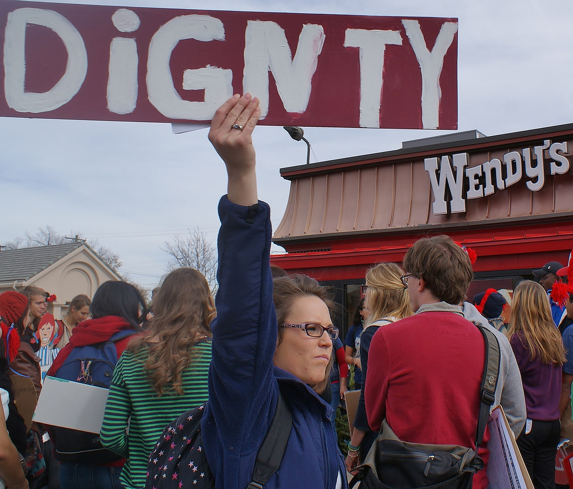 Students from Regis University, members of Jobs with Justice and area unions,  demonstrated in front of a Denver Wendy's, in support of the Fair Food Program, which protecs the rights of farmworkers and improves wages and working conditions.