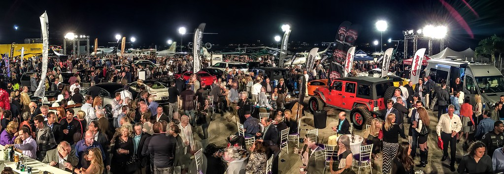 Boca Aviation Tarmac and Hangar crowds at Concours d'Elegance's Hangar Party at Boca Aviation with thousands attending