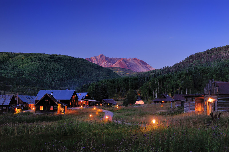 Dunton Hot Springs by night with lanterns burning along the path way
