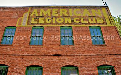 American Legion Club signage on the side of a brick building in Bisbee, Arizona