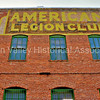 American Legion Club signage on the side of a brick building in Bisbee, Arizona