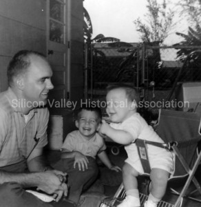 A father with his young sons in 1960