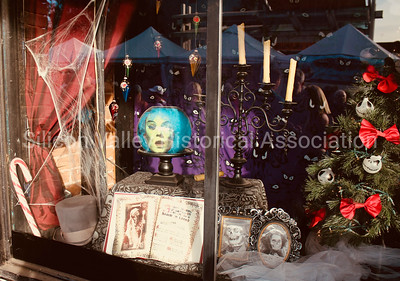 Storefront with Halloween and Christmas display on Fourth Avenue in Tucson, Arizona