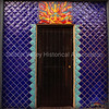 Southwestern style tiled building entrance with the sun and a lizard