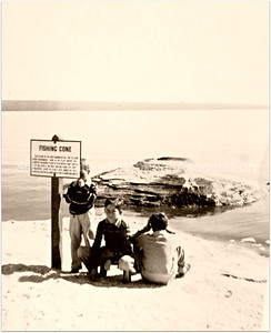 Kids standing by the fishing cone at Yellowstone National Park in 1938