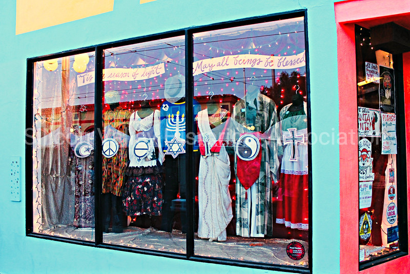 Thrift store on Fourth Avenue in Tucson, Arizona - with Coexist themed window display