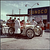 Vintage white car at a Sunoco station in Standish, Michigan in the early 1950s