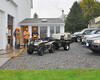 """Clients gathered outside """"The Man Room"""" (Though I was allowed, and all women most certainly will be!) Wood stove, kitchenette, bathroom, shower, and bunk comprise this finely crafted pre/post hunt comfort spot."""