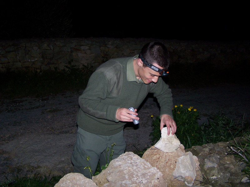 Alan looking for stones to build the mud oven
