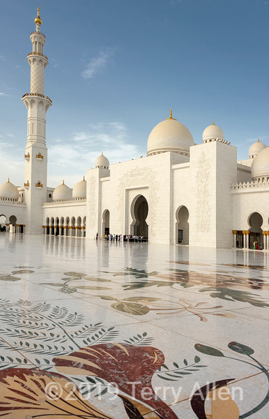 Sheikh Zayed Grand Mosque courtyard with marble inlay, arches and reflections, Abu Dhabi, UAE