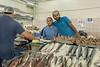 Shopkeepers with shrimp and fish for sale, Mina fish market, Abu Dhabi, UAE