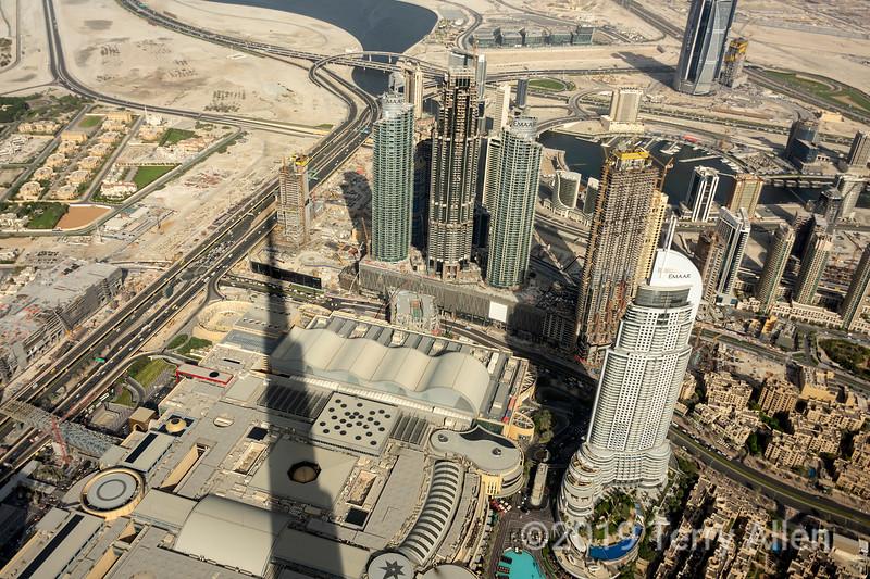 Shadow of the Burj Kalifa on the Dubai Shopping Mall and skyscrappers, Dubai, UAE