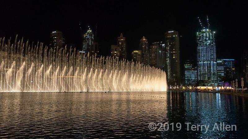 Dubai fountain and skyscrapers at night, Dubai mall, UAE