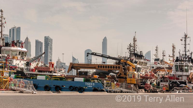 Abu Dhabi harbour with distant skyscrapers, Abu Dhabi, UAE