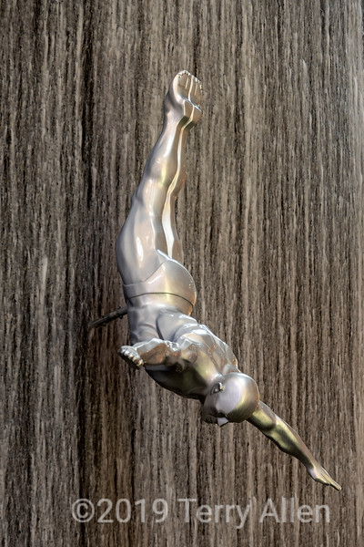 Human waterfall, male diver, vertical,, Dubai Shopping Center, Dubai, UAE