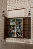 Shop window with old wooden shutters and coral block, Souk Al Arsah, Sharjah, UAE