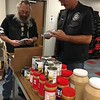 Richard Payerchin - The Morning Journal <br> United Auto Workers Local 2000 Motorcycle Committee Alternate John Woodruff, left, and Road Captain 2 Dave Alten check for expiration dates on bags of dried beans at the St. Elizabeth Center, a homeless shelter operated by Catholic Charities of the Diocese of Cleveland. The committee volunteered at the shelter on Sept. 30, 2017, helping put the food supplies in order.
