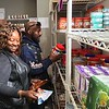 Richard Payerchin - The Morning Journal <br> United Auto Workers Local 2000 Motorcycle Committee Treasurer Sheila Johnson, left, and Sergeant at Arms Terrell Calhoun sort food at the St. Elizabeth Center, a homeless shelter operated by Catholic Charities of the Diocese of Cleveland. The committee volunteered at the shelter on Sept. 30, 2017, helping put the food supplies in order.