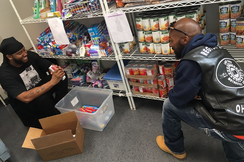 Richard Payerchin - The Morning Journal <br> United Auto Workers Local 2000 Motorcycle Committee member Deshawn Chatman, left, and Sergeant at Arms Terrell Calhoun work the shelves at the St. Elizabeth Center, a homeless shelter operated by Catholic Charities of the Diocese of Cleveland. The committee volunteered at the shelter on Sept. 30, 2017, helping put the food supplies in order.