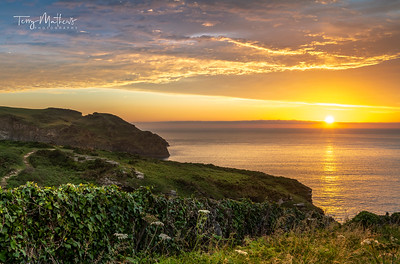 UK Weather. Beautiful sunset at Bossiney Cove near Tintagel in North Cornwall.