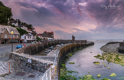 UK Weather: Approaching storms after sunset in Lynmouth, North Devon, England.