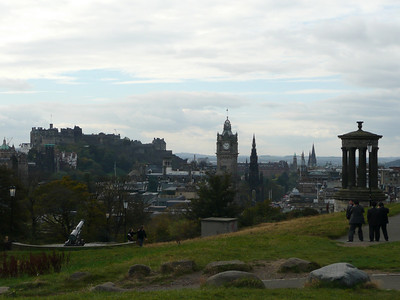 Edinburgh Castle far away on the left, the Dugald Stewart Monument on the far right