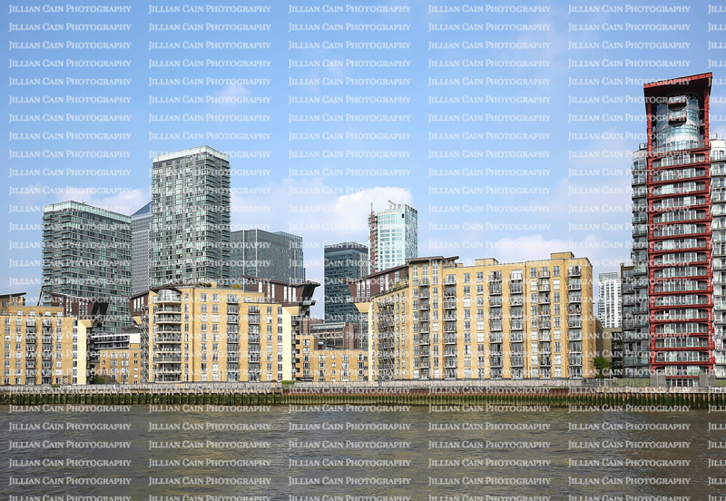 Flats and commercial buildings in the Isle of Dogs area as seen from the River Thames.