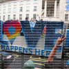 "As the beginning of the London Gay Pride Parade the ""LOVE HAPPENS HERE"" float reflects the theme of this years parade."
