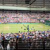The spectators fill every seat at the Championship Wimbledon at Centre Court in Wimbledon, London .