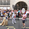 Drag couple dressed as Queen Elizabeth the II and her husband Prince Philip, Duke of Edinburgh walk in the London Gay Pride Parade.