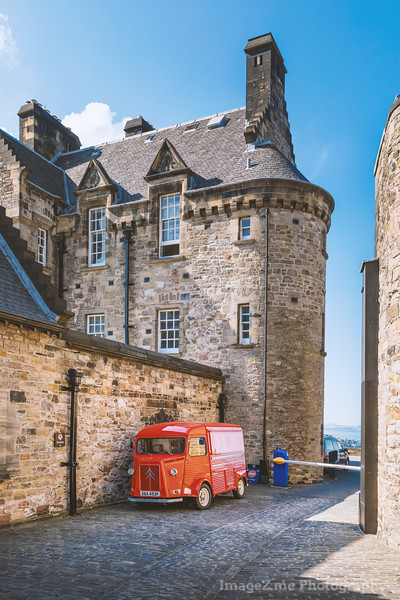 A vibrant red Citroen Truck parked Old street in Edinburgh Castle