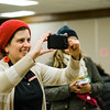 Executive Director Joana Dos Santos snaps some photos during the United Neighbors of Fitchburg's annual Three Kings Day celebration at St. Joseph Church on Friday evening. SENTINEL & ENTERPRISE / Ashley Green