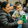 One-year-old Rafael Antonio Rivera enjoys a cracker with Brendalies Rivera during the United Neighbors of Fitchburg's annual Three Kings Day celebration at St. Joseph Church on Friday evening. SENTINEL & ENTERPRISE / Ashley Green