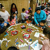 Children create paper crowns during the United Neighbors of Fitchburg's annual Three Kings Day celebration at St. Joseph Church on Friday evening. SENTINEL & ENTERPRISE / Ashley Green