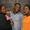 Isaac Nomo who became a US Citizen is flanked by Renita Frimpong and Vivian Aidao.<br /> Sentinel & Enterprise / Jim Fay